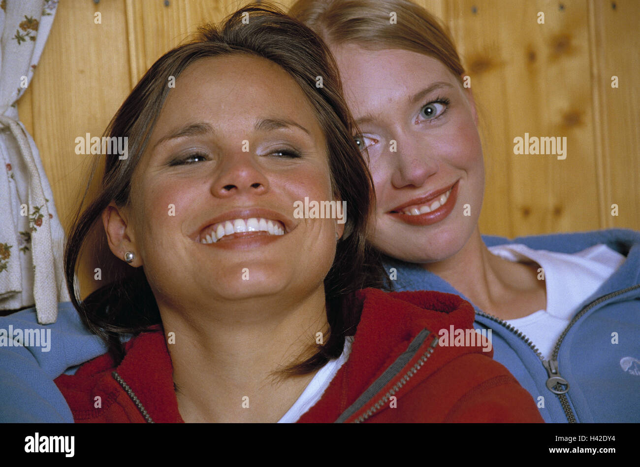 Steelworks evening, women, young, fun, amusement, happy, hut, friends, 20-30 years, friendship, trust, suture, embrace, - Stock Image