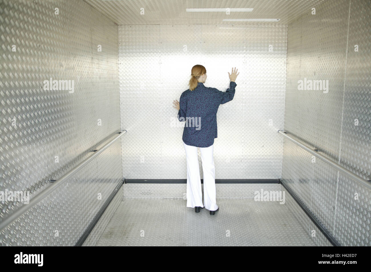 Lift, woman, young, back view, helplessly, hopelessly, 15 - 20 years, young persons, trainees, trainee, lift, lift, - Stock Image