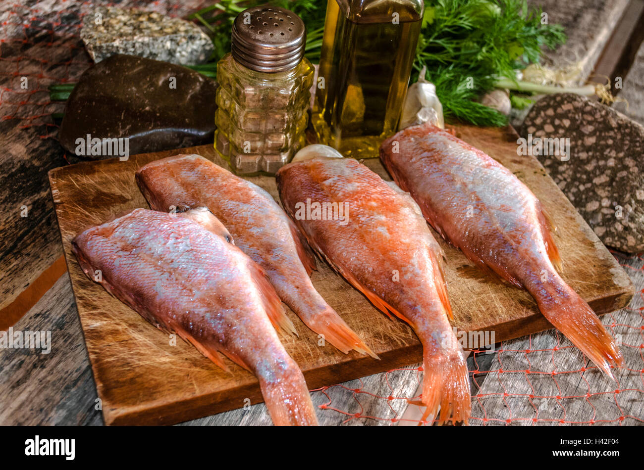 Processed carcasses of red grouper with herbs and spices - Stock Image