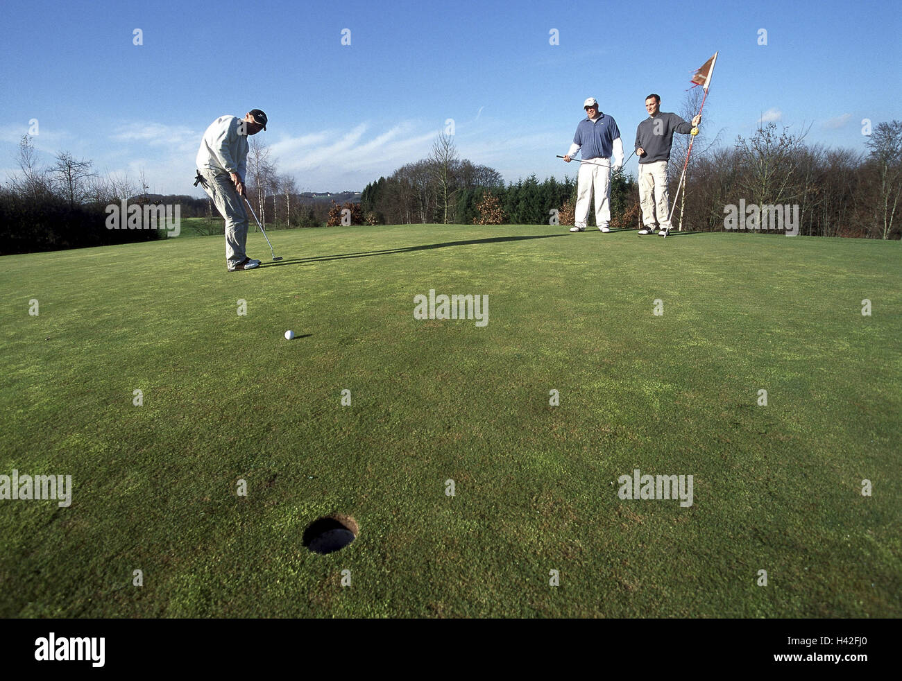 Golf course, golfer, man, putt, no model release Golf tournament, men, to golfs, Golf, Getting, hole, put in clink, - Stock Image
