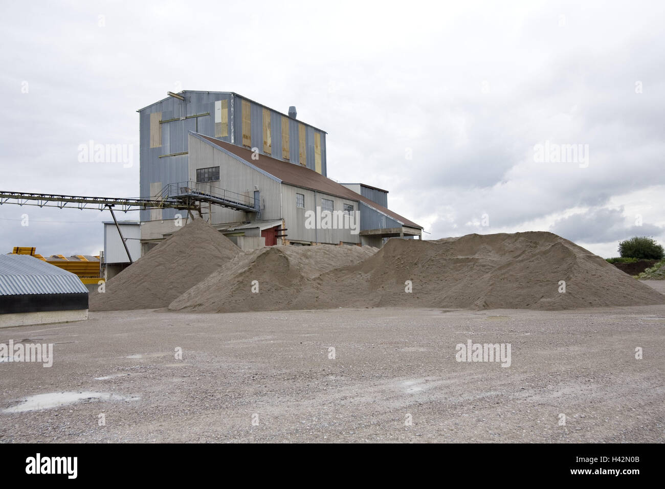 Gravel opus, no property release, Sand company, gravel company, opus, company, factory, quarry, heap, gravel heap, - Stock Image