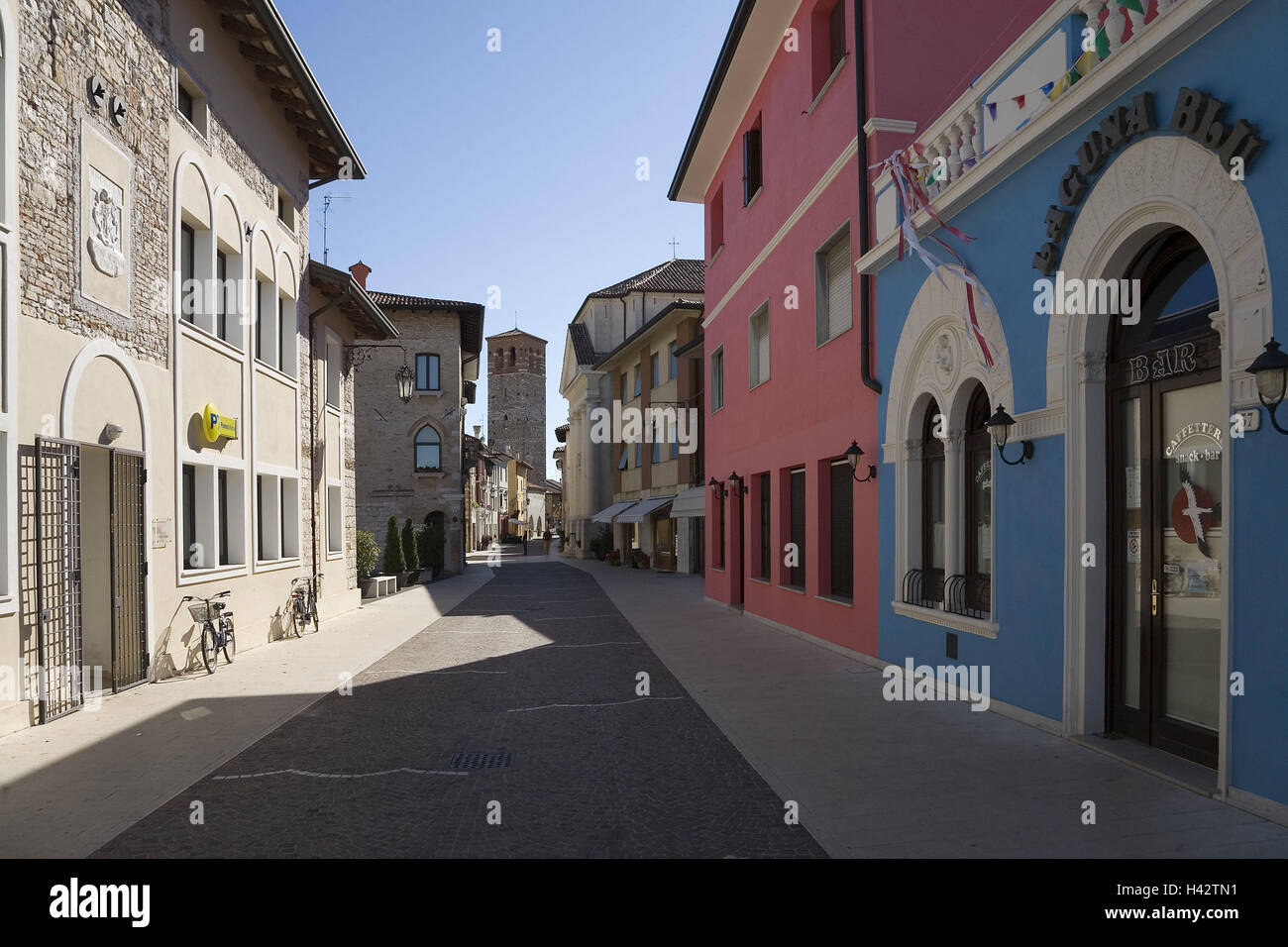 Italy, Marano Lagunare, lane, deserted, town, houses, buildings, house facades, brightly, colourfully, street, shopping - Stock Image