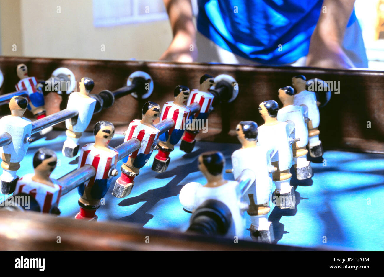 Person, table football, detail, table football match, football player, leisure time, entertainment, game, sticks, - Stock Image