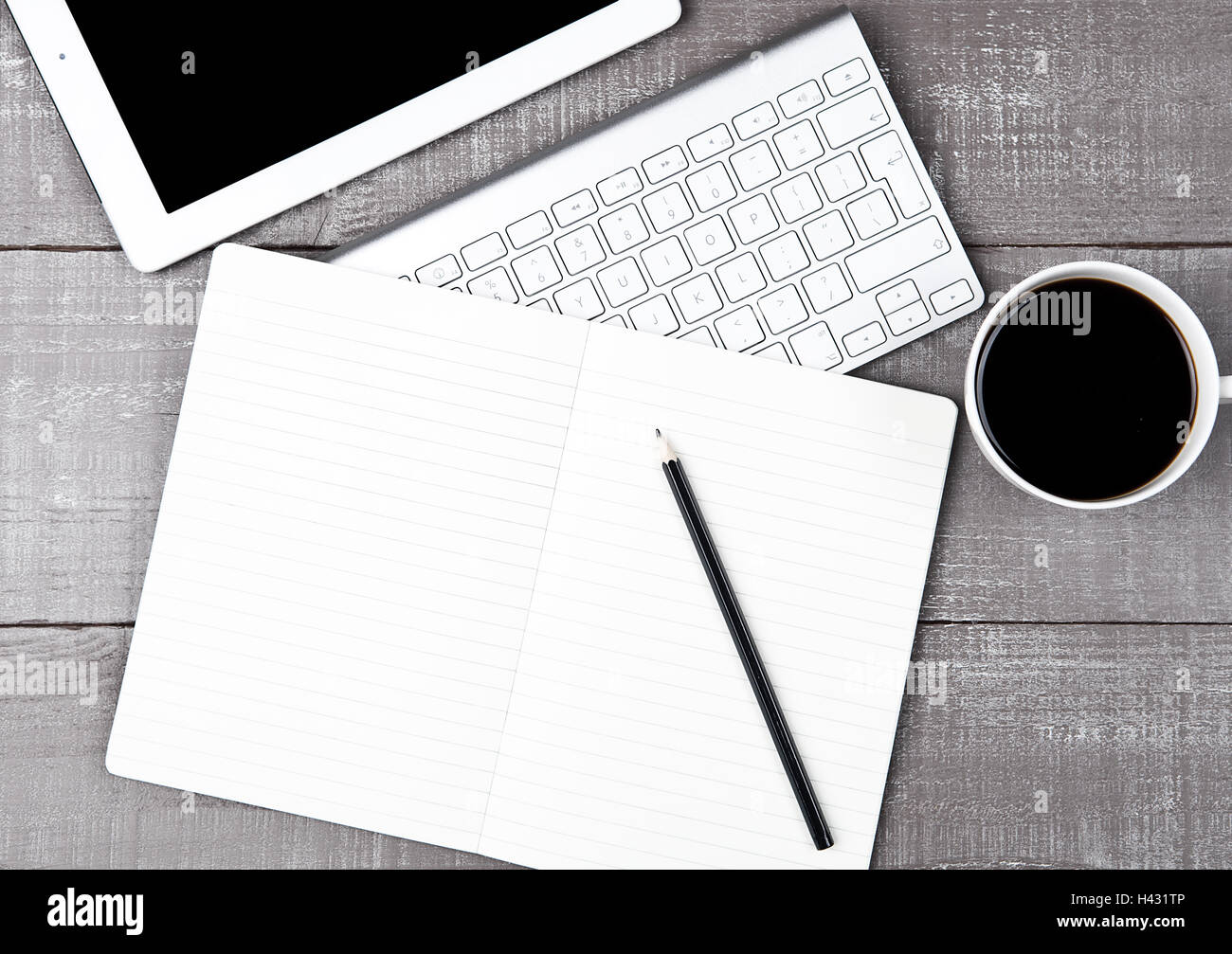 Keyboard with pencil and  coffee cup and tablet on office desk Stock Photo