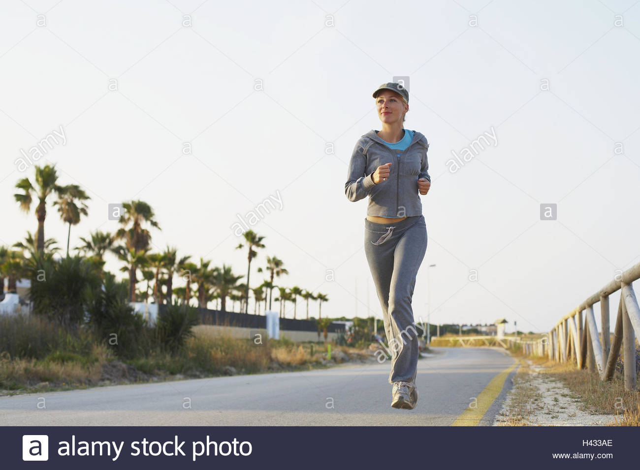 Woman, young, boardwalk, jogging, - Stock Image