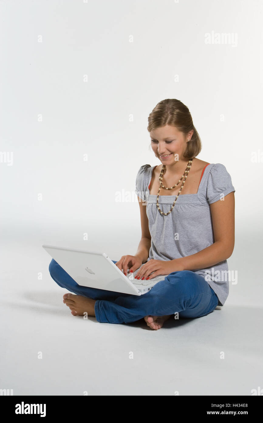 Young persons, girls, sit, smile, laptop, data entry, model released, no property release, person, teenager, computer, - Stock Image