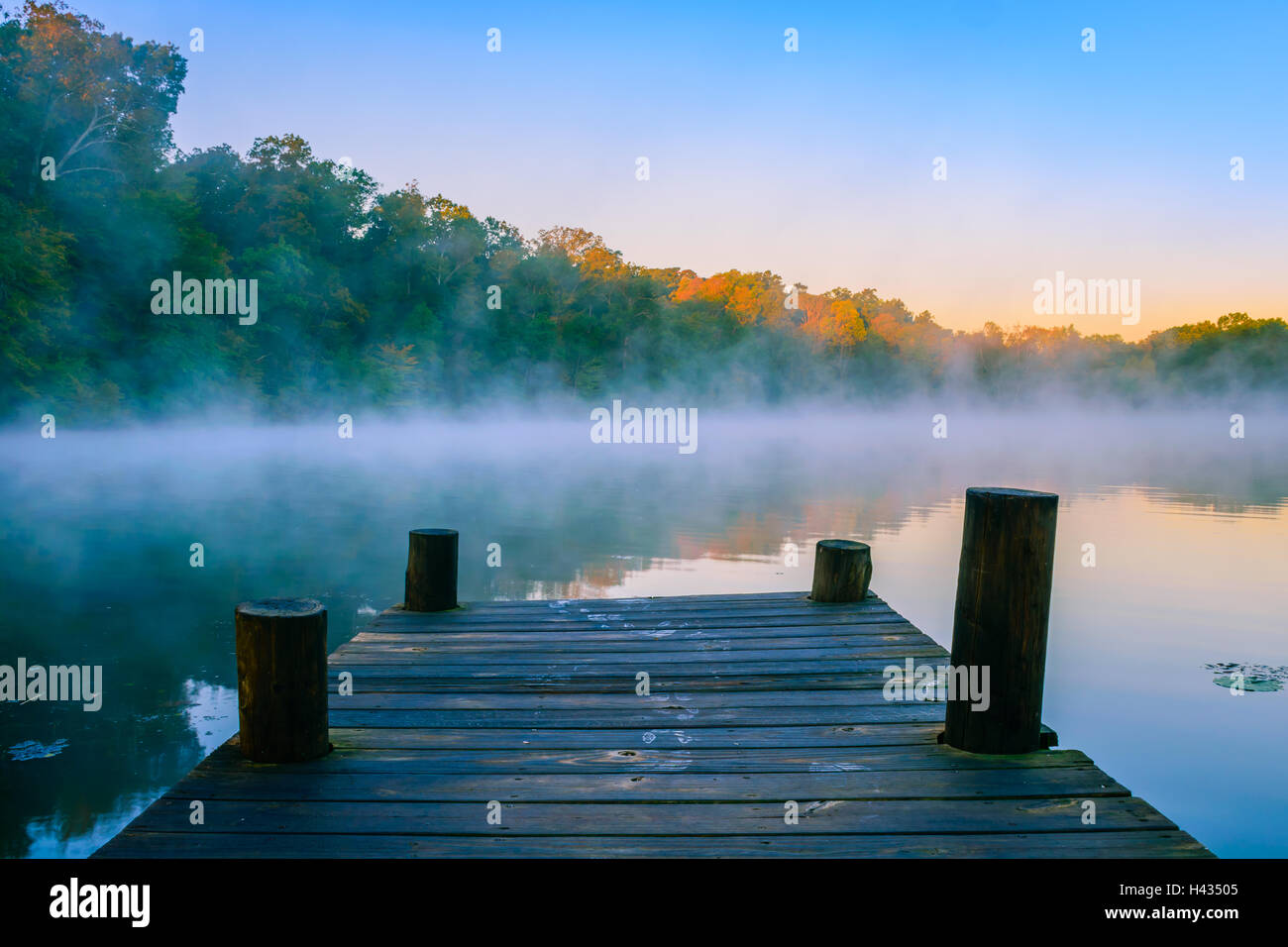 Morning mist on reflective water, Mt Saint Francis, Indiana.ff - Stock Image