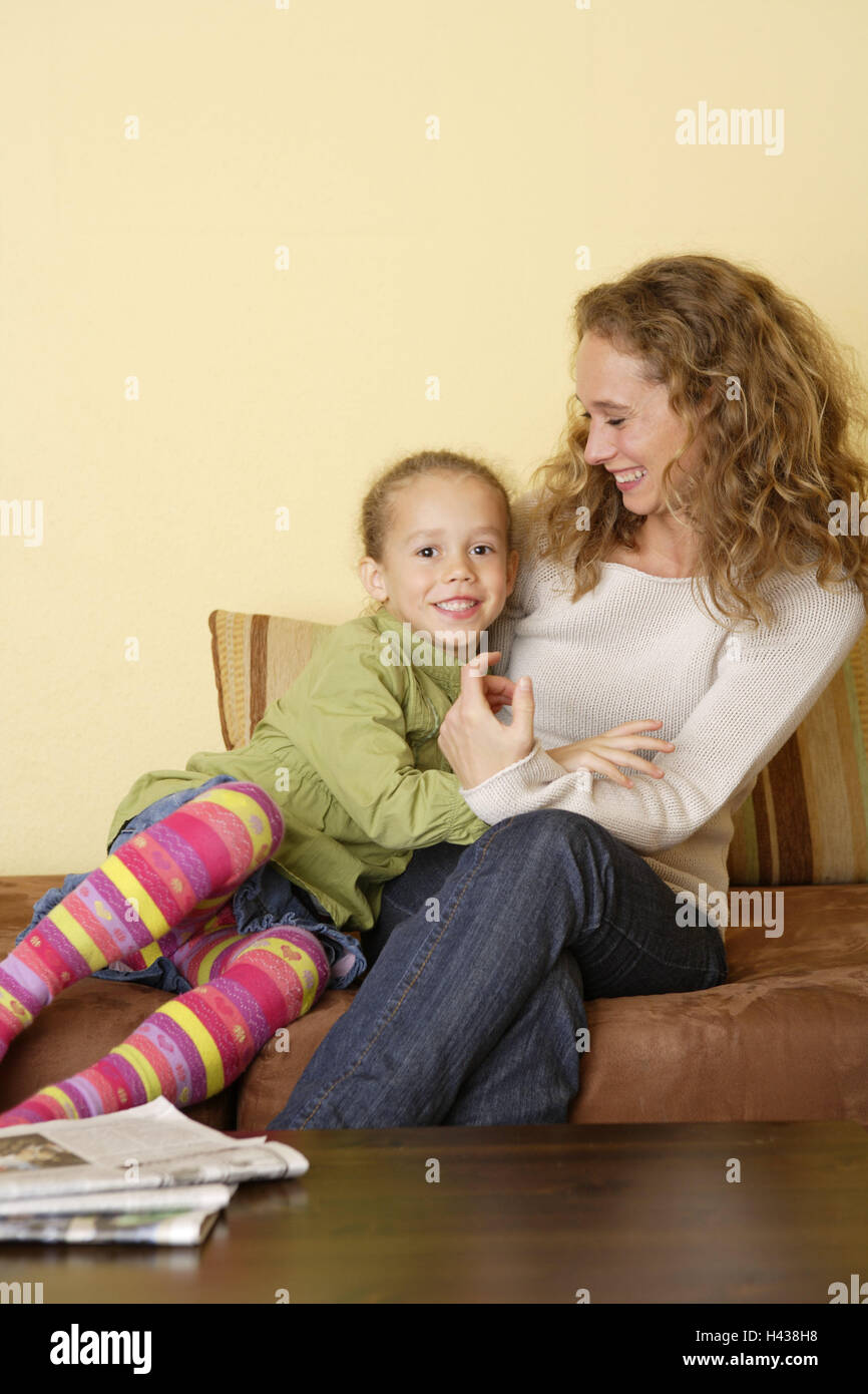 Sitting rooms, woman, subsidiary, sofa, sit, happy, people, nut, child, girl, blond, embrace, suture, happy, fun, - Stock Image