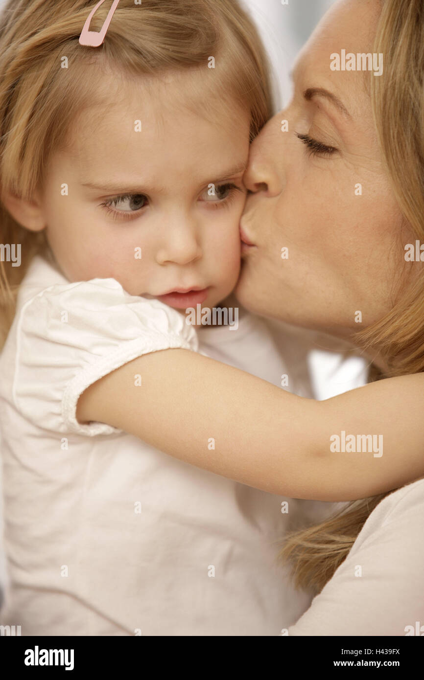 Nut, subsidiary, embrace, comfort, model released, people, woman, child, girl, blond, side view, suture, affection, - Stock Image