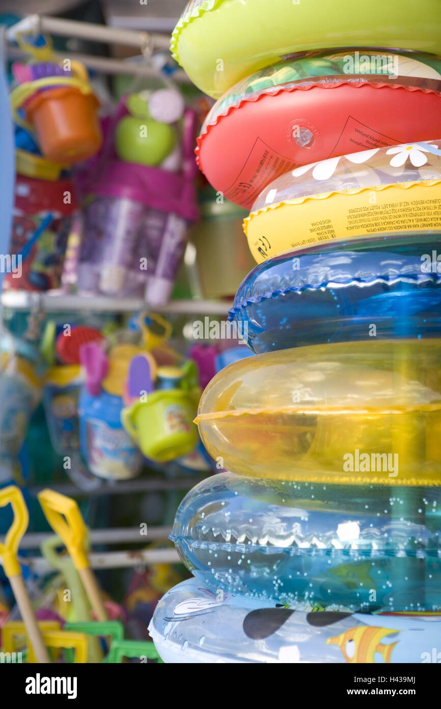 Sand toys, swimming tyre, brightly, bath implements, passed away, hang rubber dinghy, plastic tyre, stacked, toys, Stock Photo