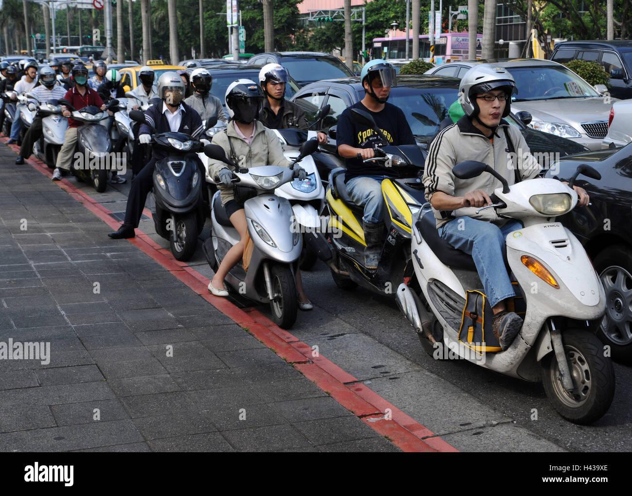Motorcyclist, cars, Taipeh, Taiwan, - Stock Image