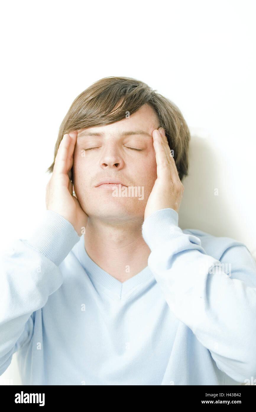 Man, cephalalgias, temples, massage, portrait, person, brunette, of a headache, disease, migraine, thoughtful, complaints, - Stock Image
