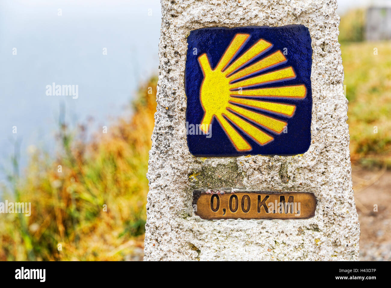 Zero kilometer marker showing the end of the Pilgrimage Camino of Finisterre, final point, Way of St. James, A Coruña - Stock Image