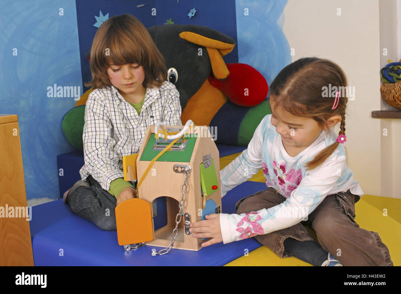 Children, two, play, learning game, kindergarten, person, girl, boy, wooden house, wooden toys, learning toys, toys, Stock Photo