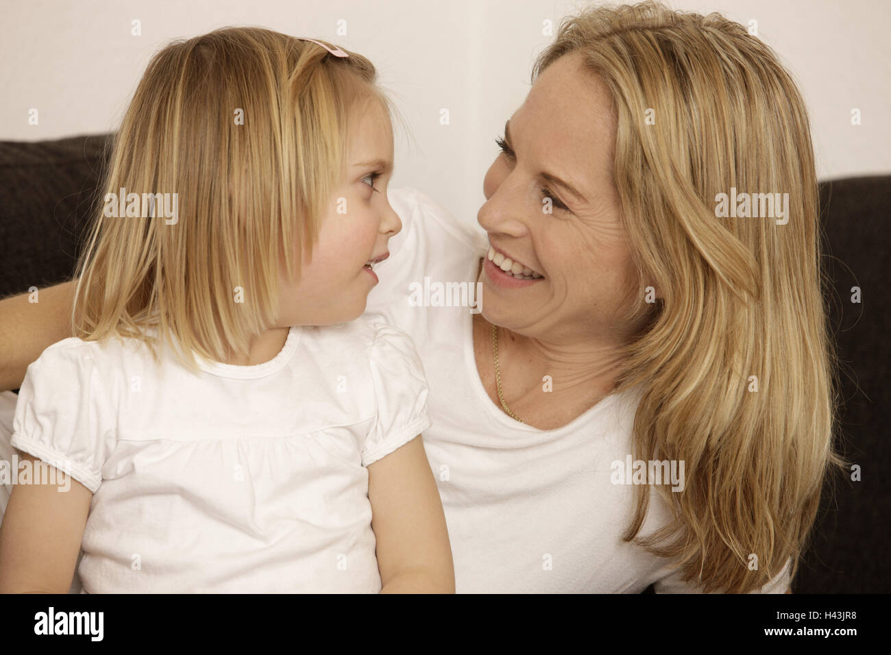 Nut, subsidiary, eye contact, smile, portrait, model released, people, woman, child, girl, blond, side view, suture, - Stock Image
