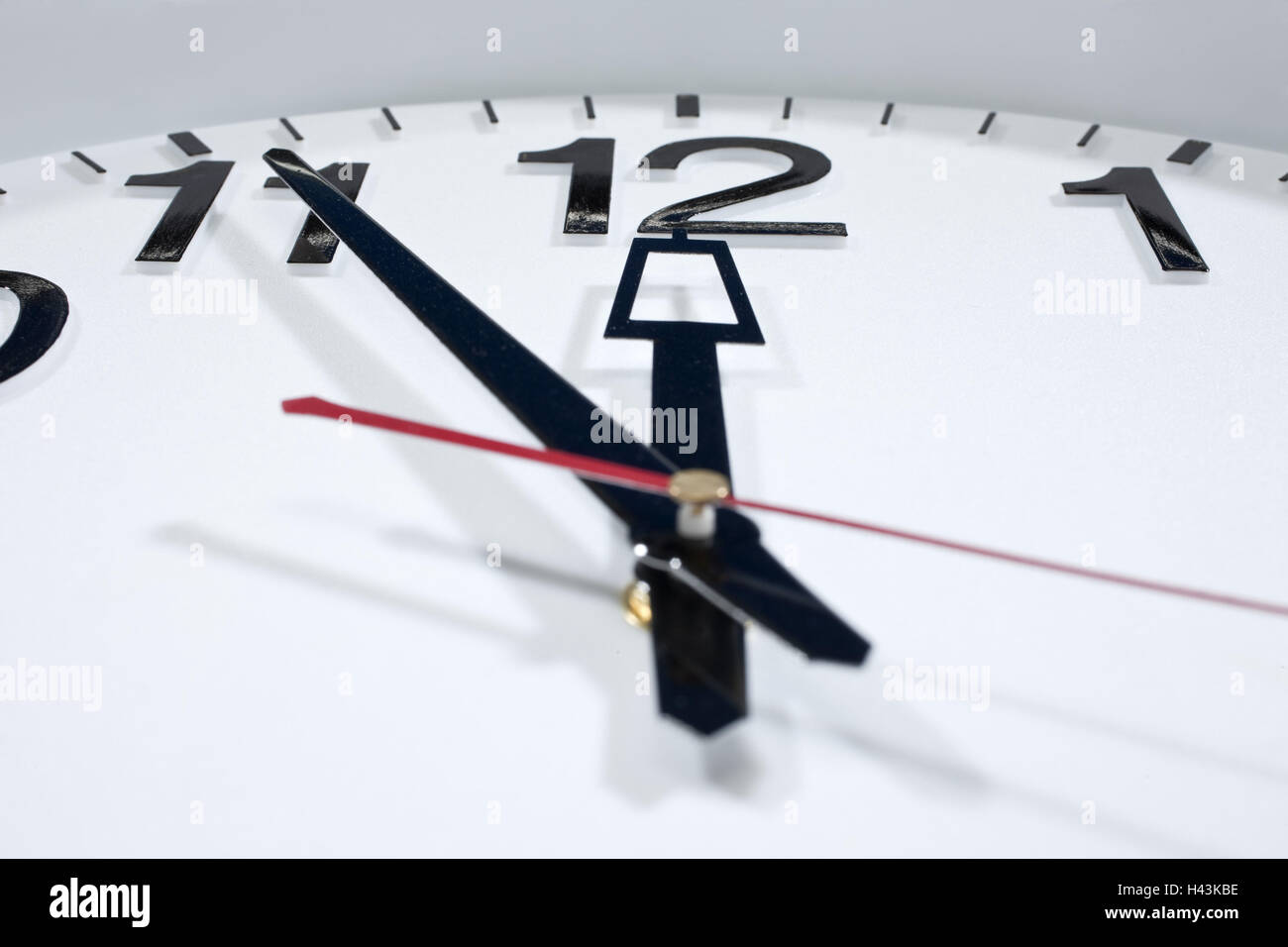 Wall clock, five in front of twelve, close up, - Stock Image