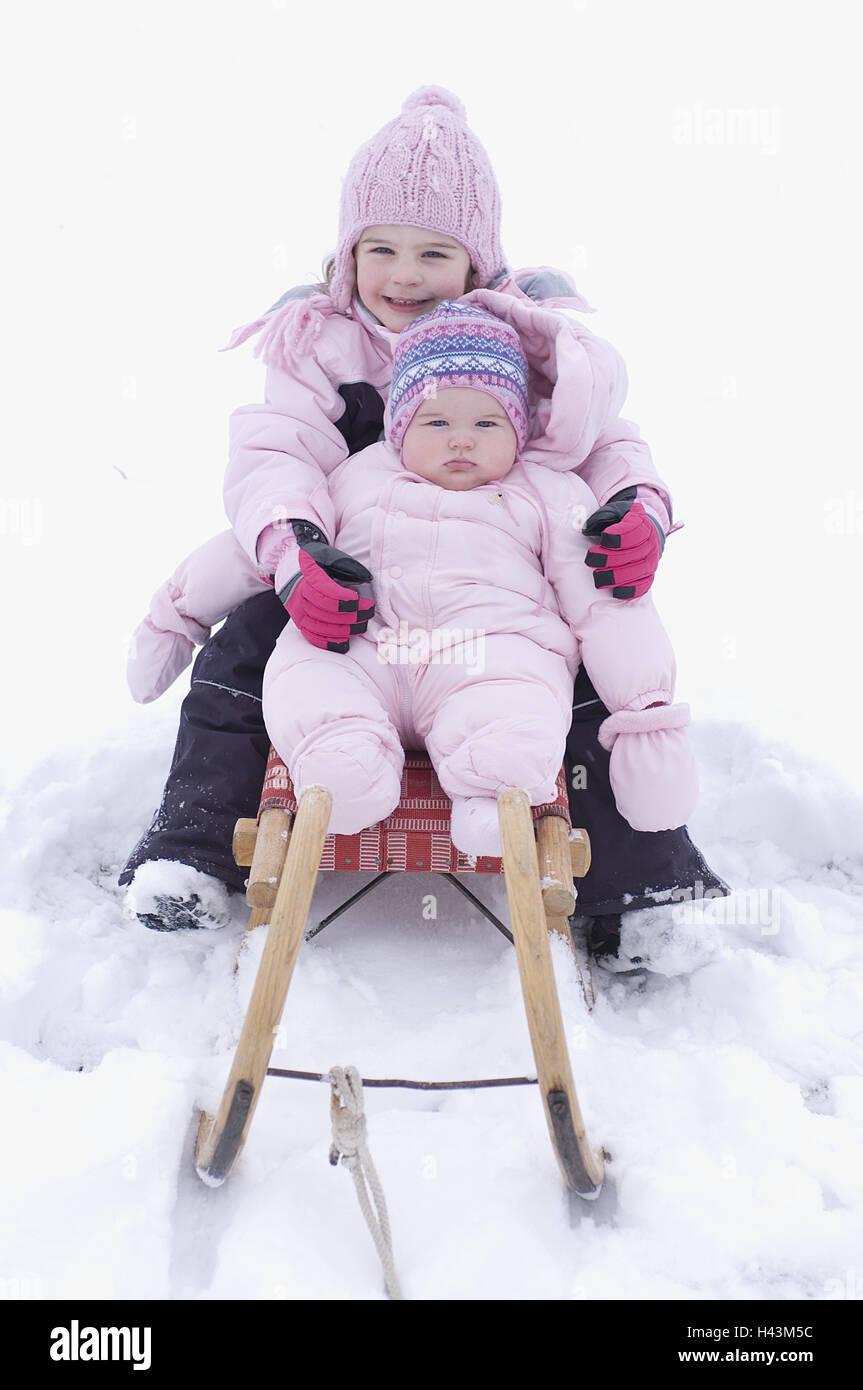 Children sit on slide, - Stock Image