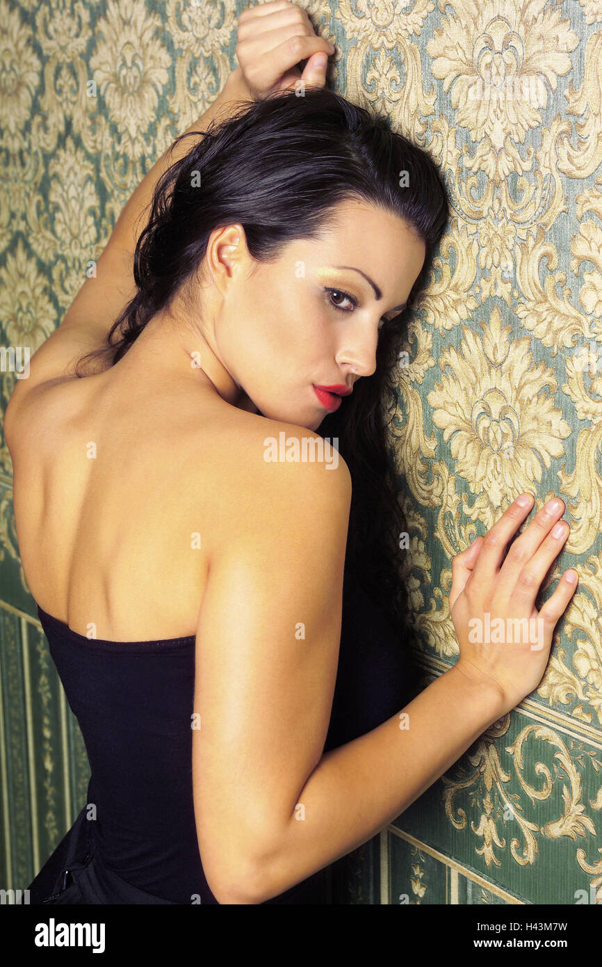 Woman, dress, strapless, wall, lean, seduction, - Stock Image