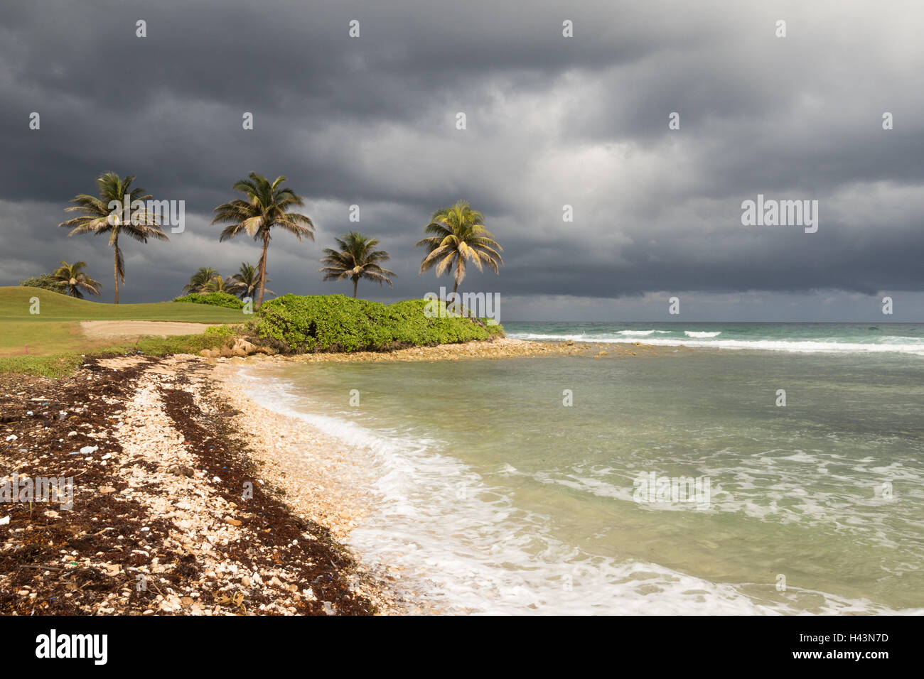 Stormy beach front in Jamaica - Stock Image