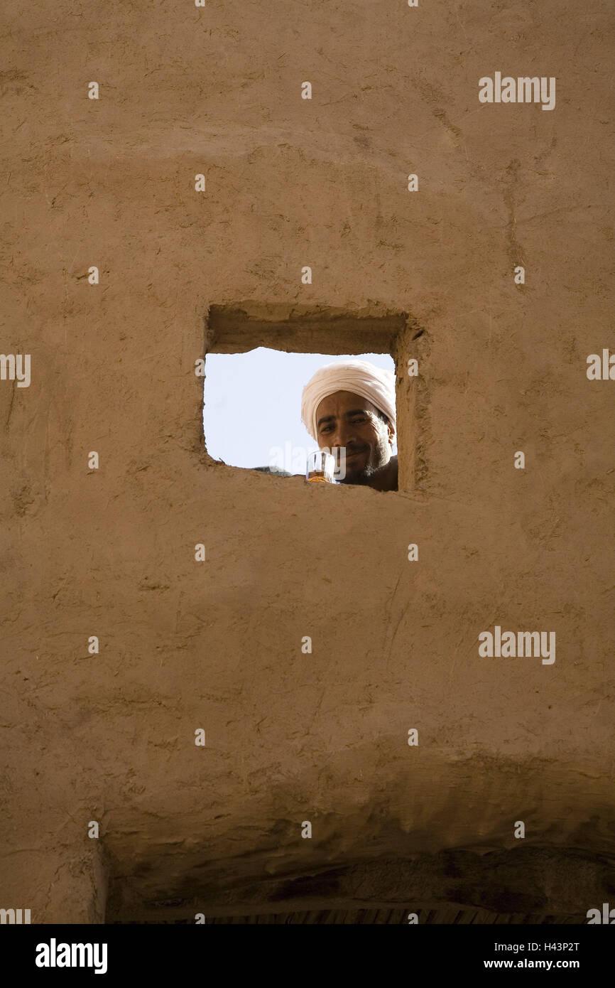 Saudi Arabia, Al-Ula, Old Town, mucky house, window, man, tea, drink, smile, buildings, house, mucky construction, - Stock Image