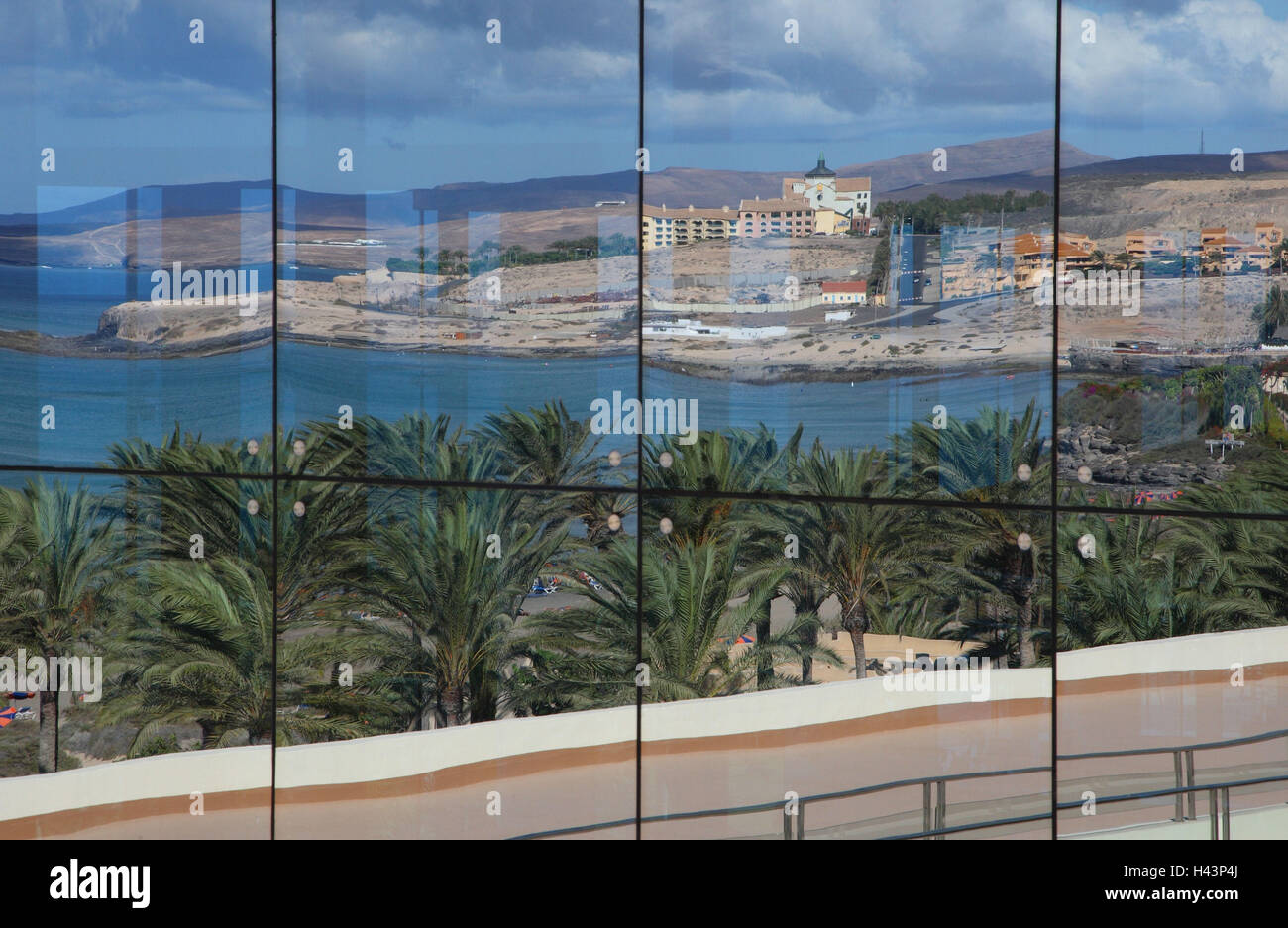 Mirroring in of a glass wall on Fuerteventura, - Stock Image