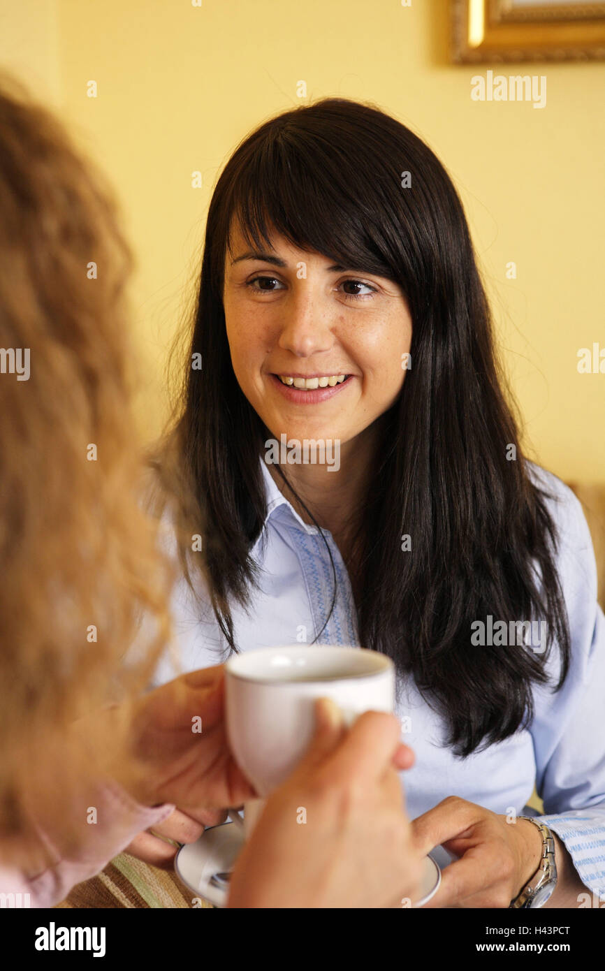 Women, coffee drink, entertainment, eye contact, curled, people, friends, sit, coffee party, conversation, happy, - Stock Image