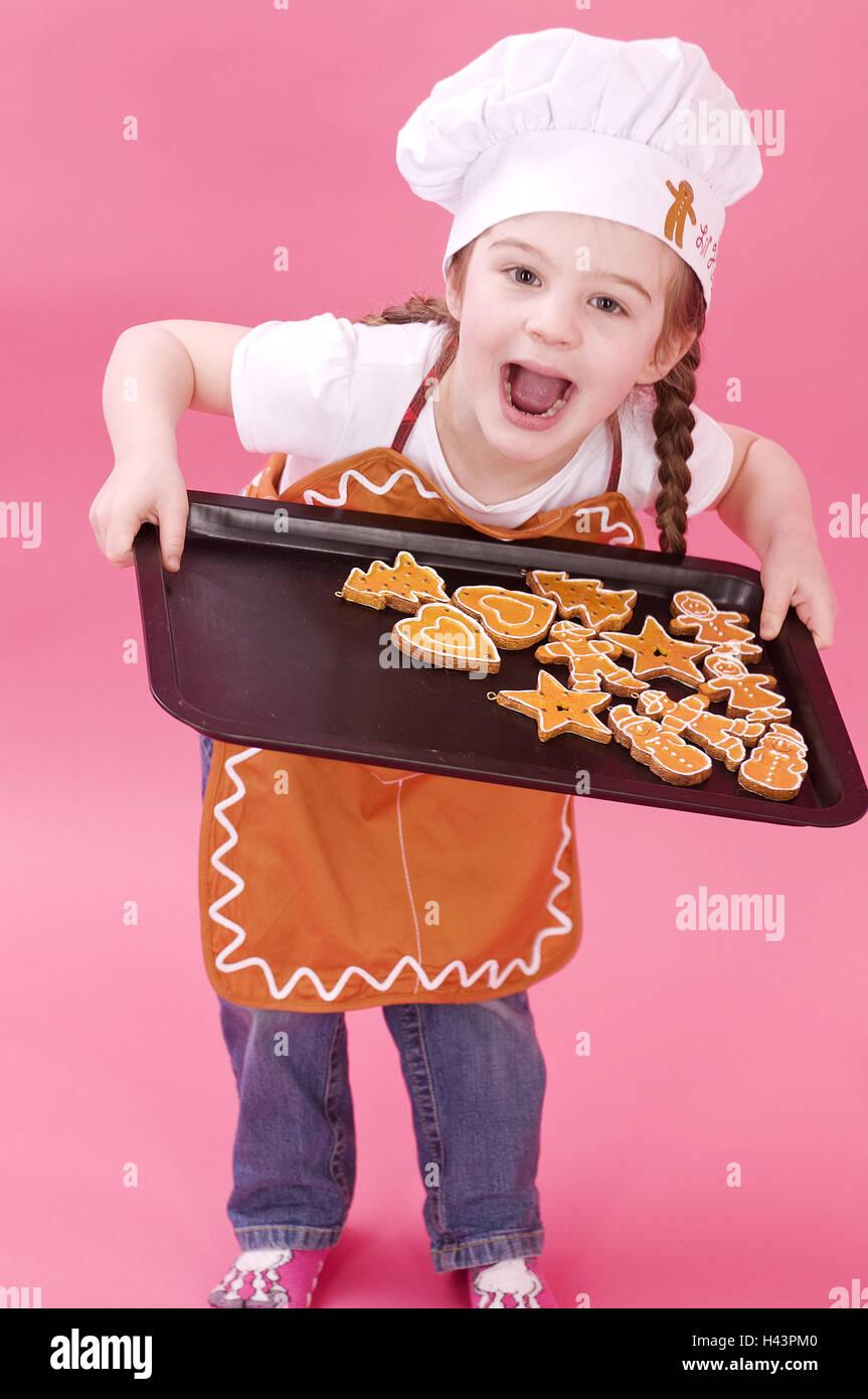Girls, baking sheet, biscuit, studio, stand, facial play, - Stock Image