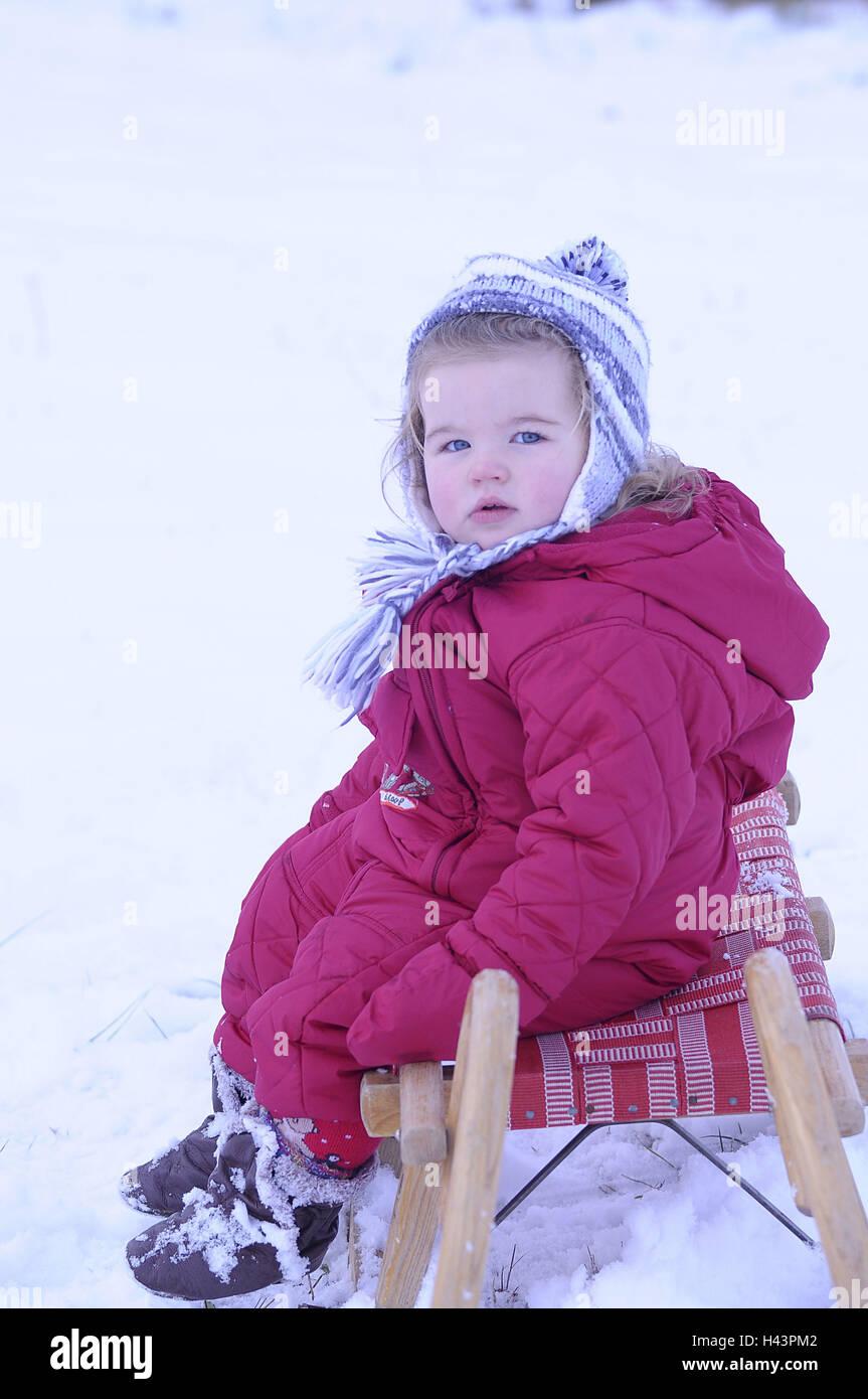 Infant, slide, snow, - Stock Image