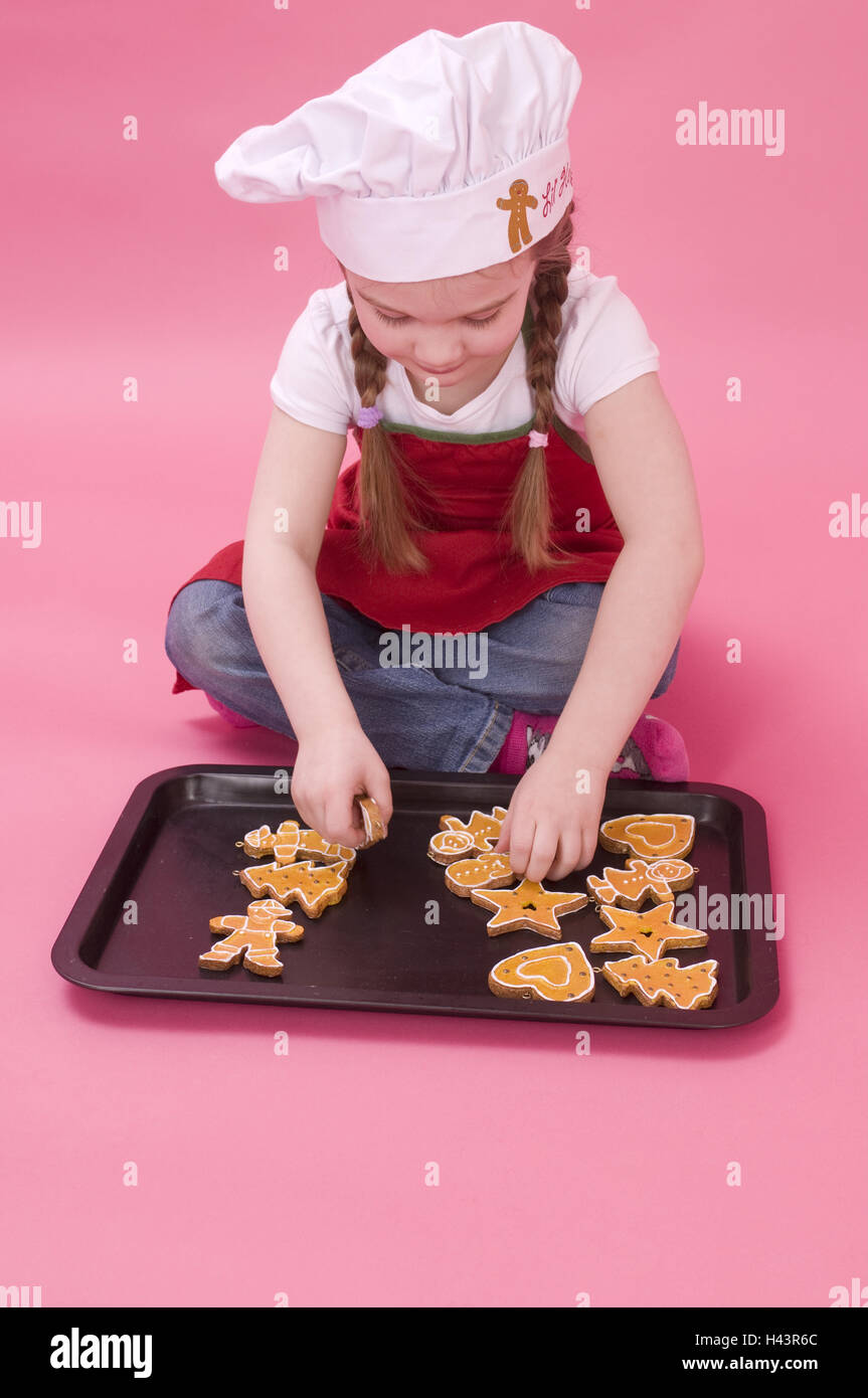 Girls, baking sheet, little place, seated, studio, - Stock Image