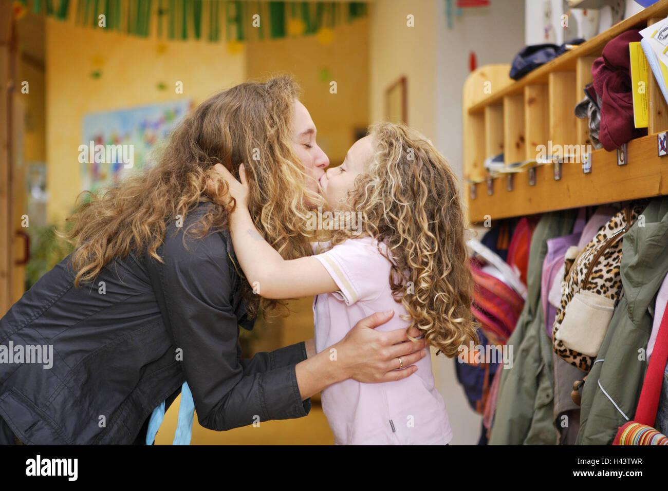 Kindergarten, mother, daughter, kiss, adoption, sidewise, people, woman, child, girl, kindergartner, blond, curls, - Stock Image