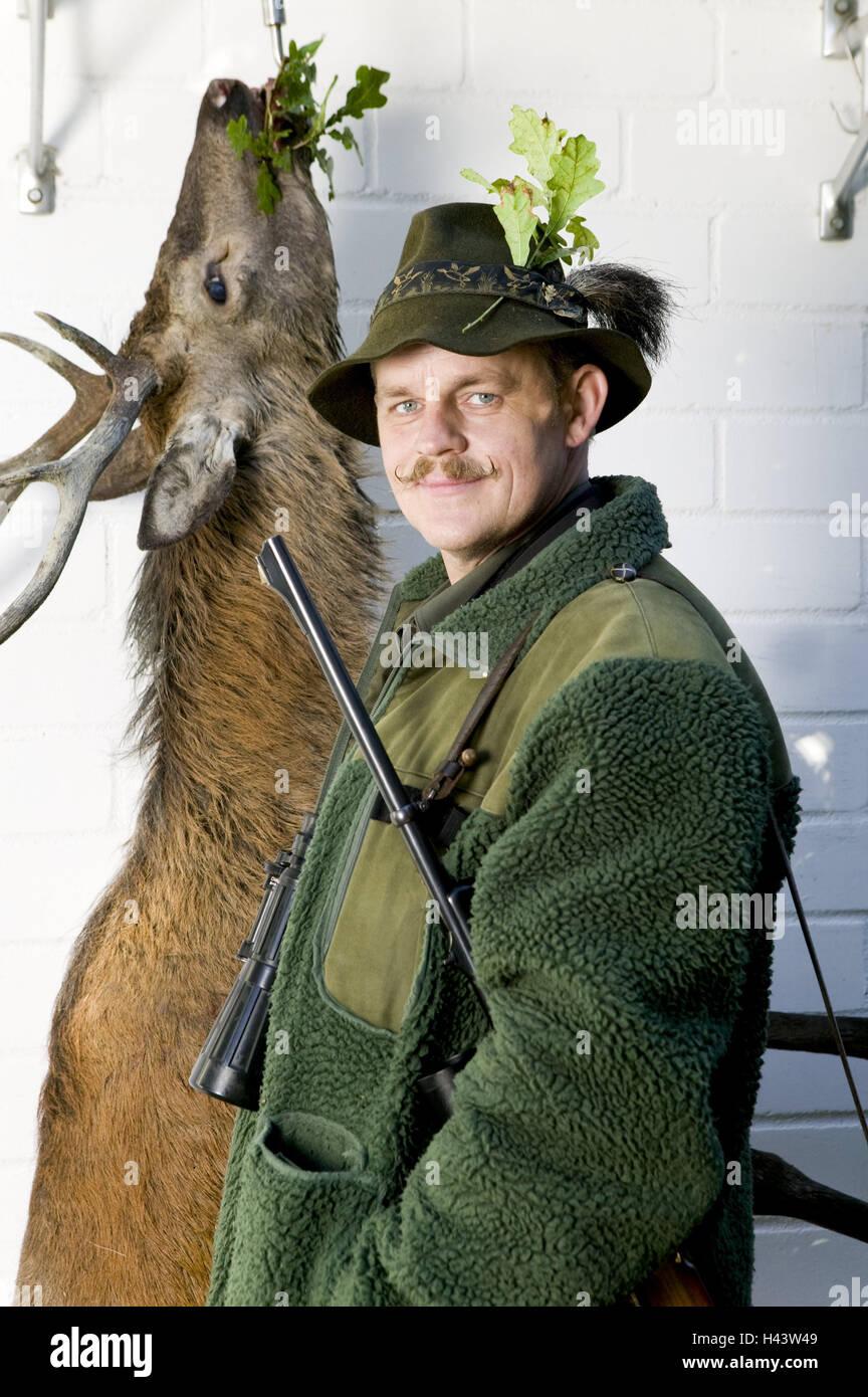 Deer, cooling, hang, hunter, prey, shoots, hunting game, half portrait, animal, hygiene, hunt, red deer, venison, - Stock Image