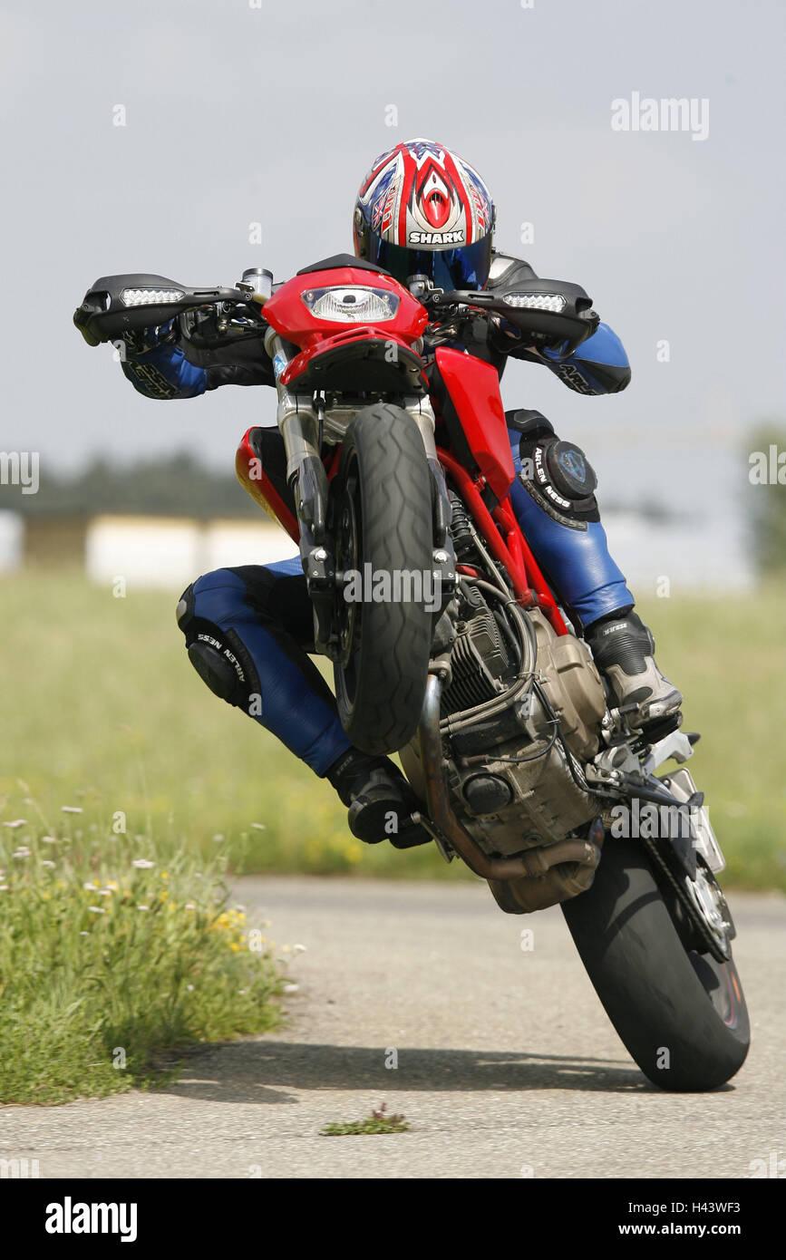 Ducati, 'Wheelie', motorcycle, street, person, driver, motorcyclist, skill, Wheelie, skill, bend, stunt, - Stock Image