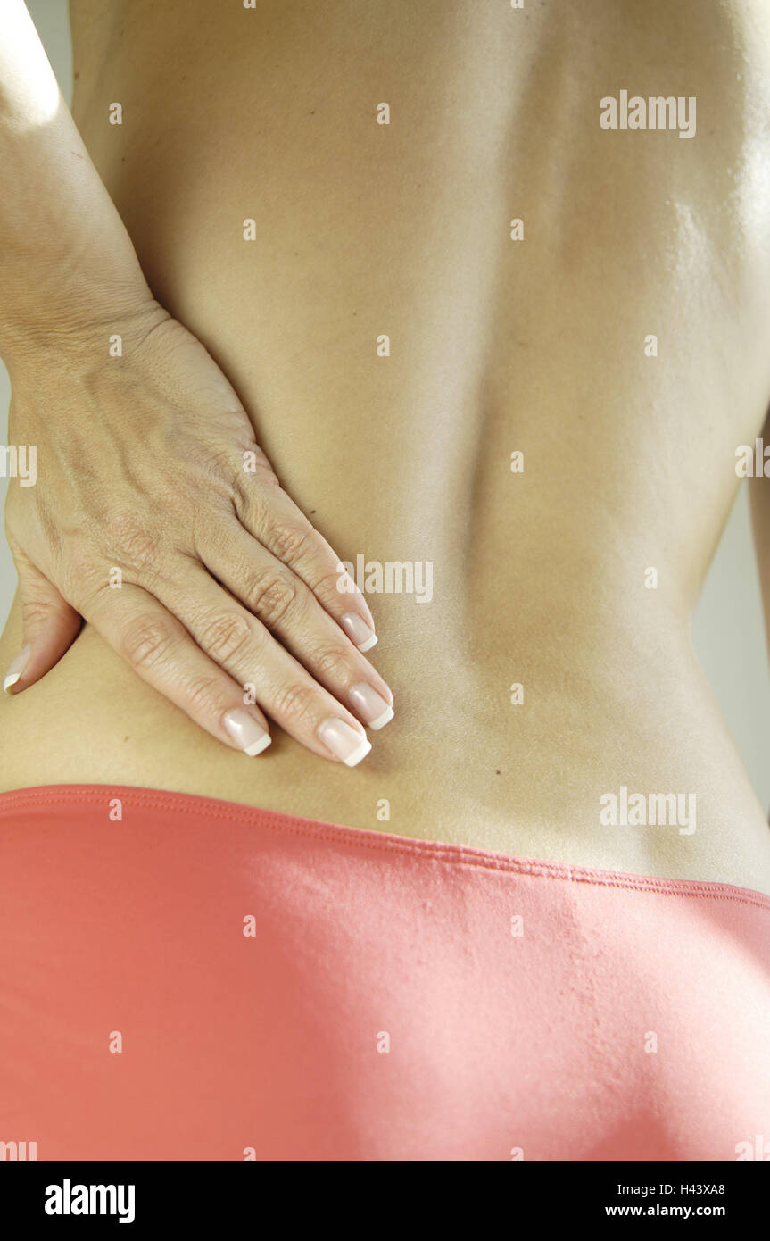 Woman, free upper body, gesture, pains, back view, detail, - Stock Image