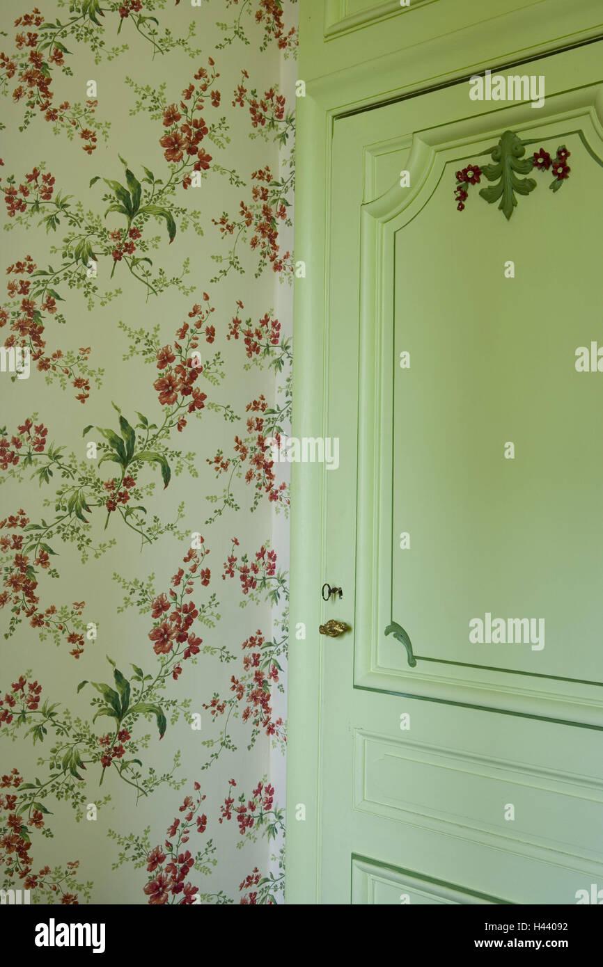 living place flowery wallpaper room corner room door green stock