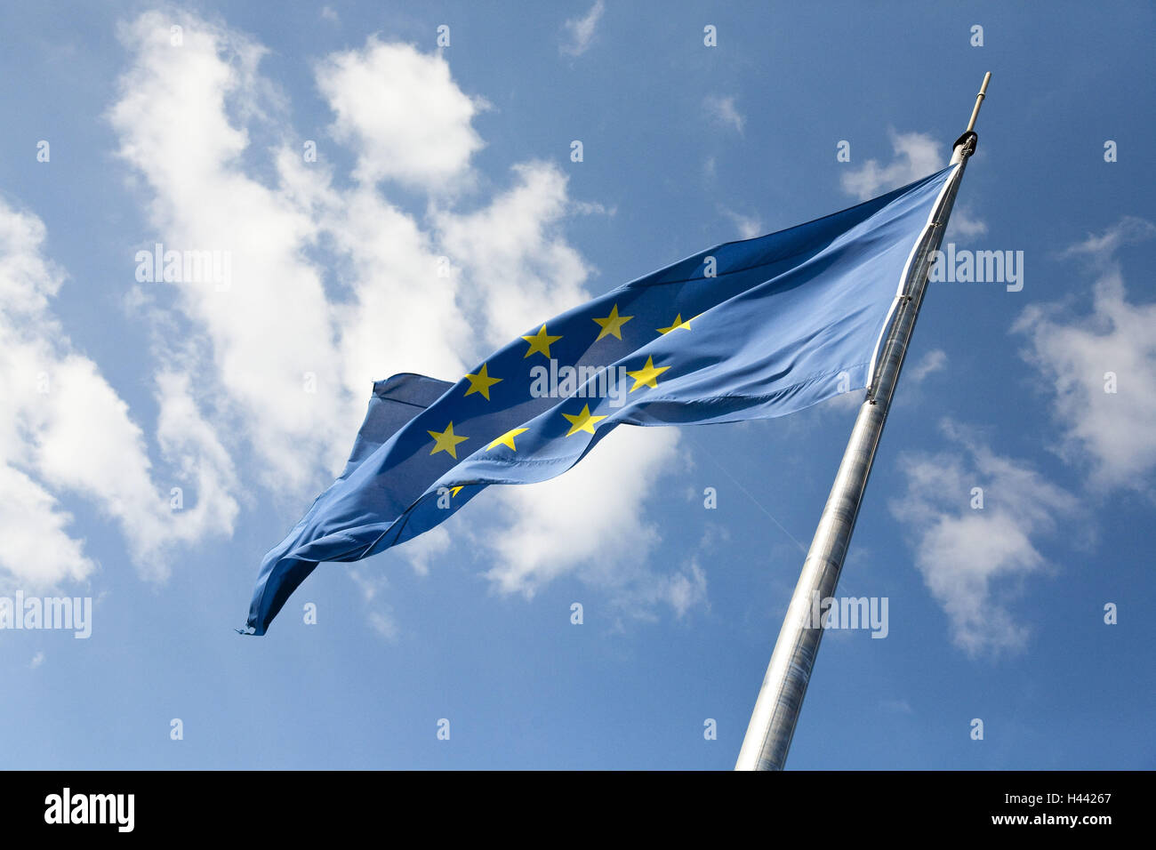 Flagpole, European flag, wind, cloudy sky, - Stock Image
