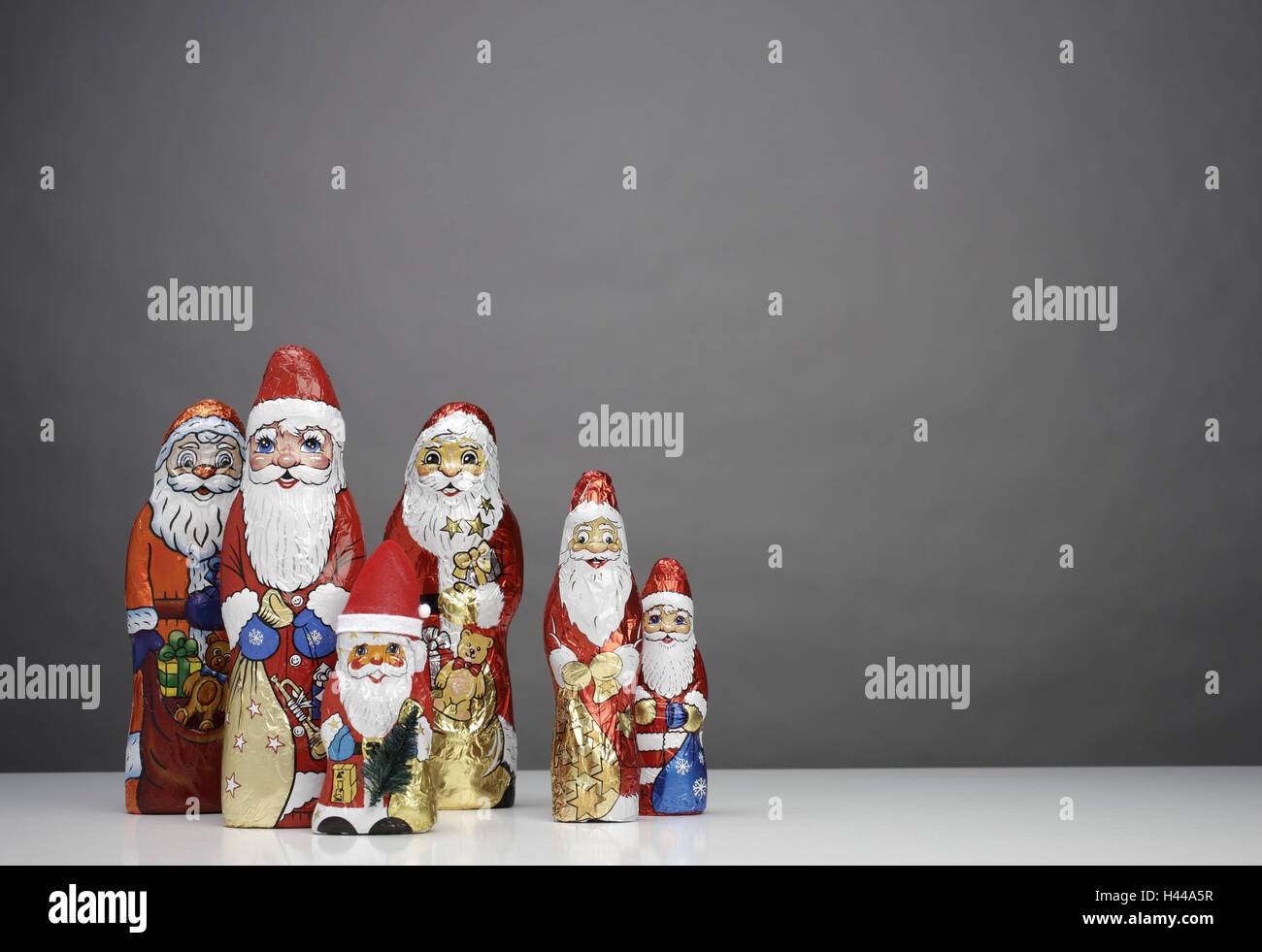 Chocolate Santa Clauses, differently, Stock Photo