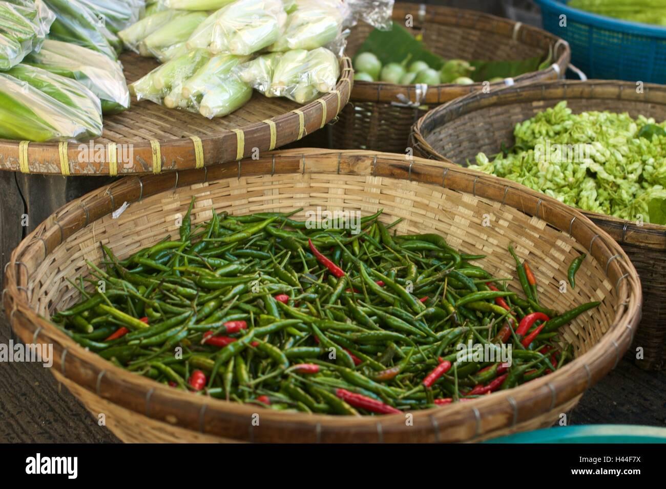 Chilli Padi, Bird's Eye Chilli, Bird Chilli, Thai pepper on Threshing basket. - Stock Image