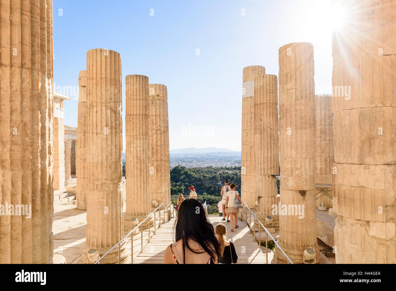 Sun shines on the columns of the Propylaea, the grand entrance to the Acropolis, Athens, Greece Stock Photo