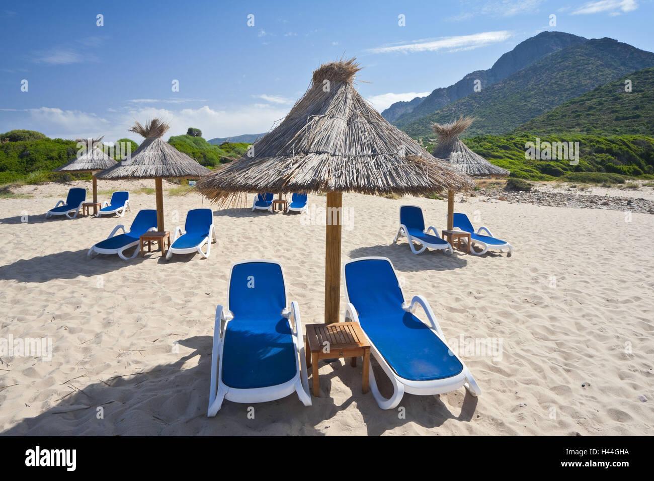 France, Corsica, beach, Capu Rossu, pest d'Arone, deck chairs, display screens, - Stock Image