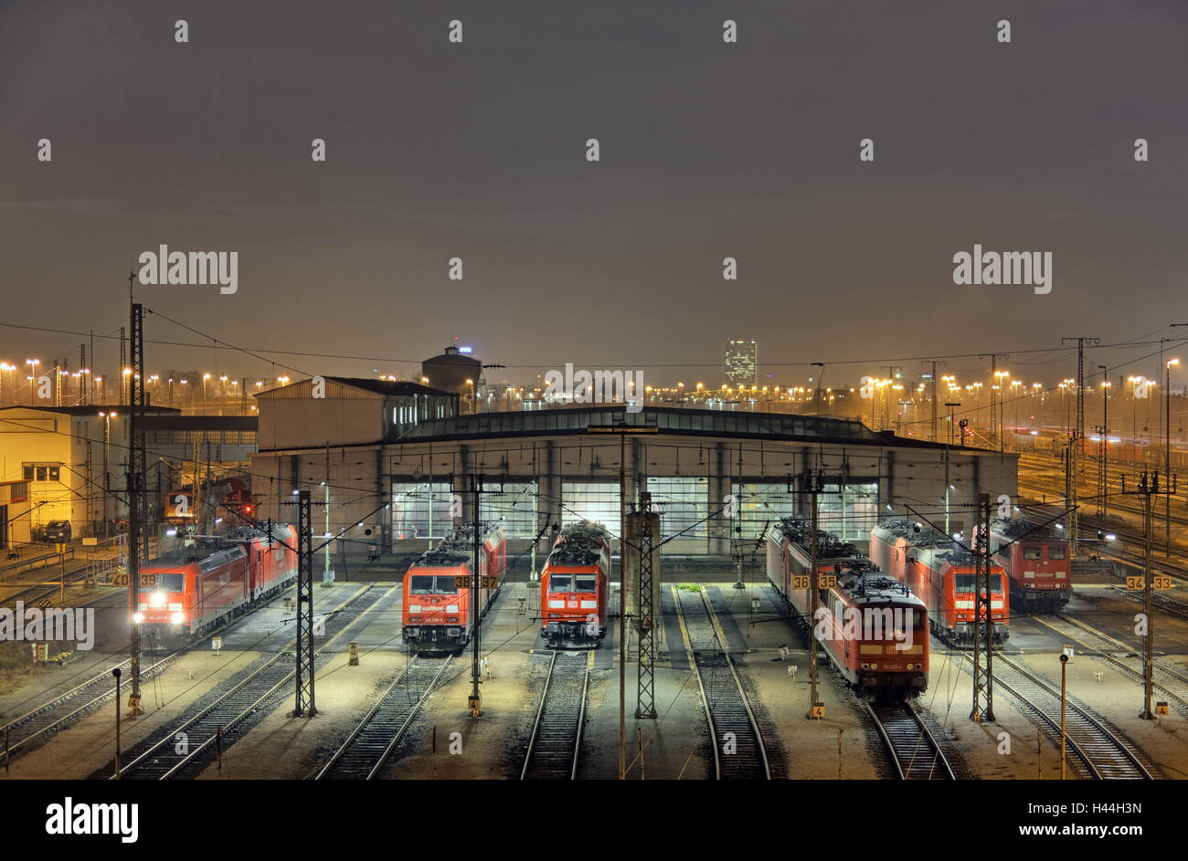 Locomotives, tracks, engine shed, night photography, - Stock Image