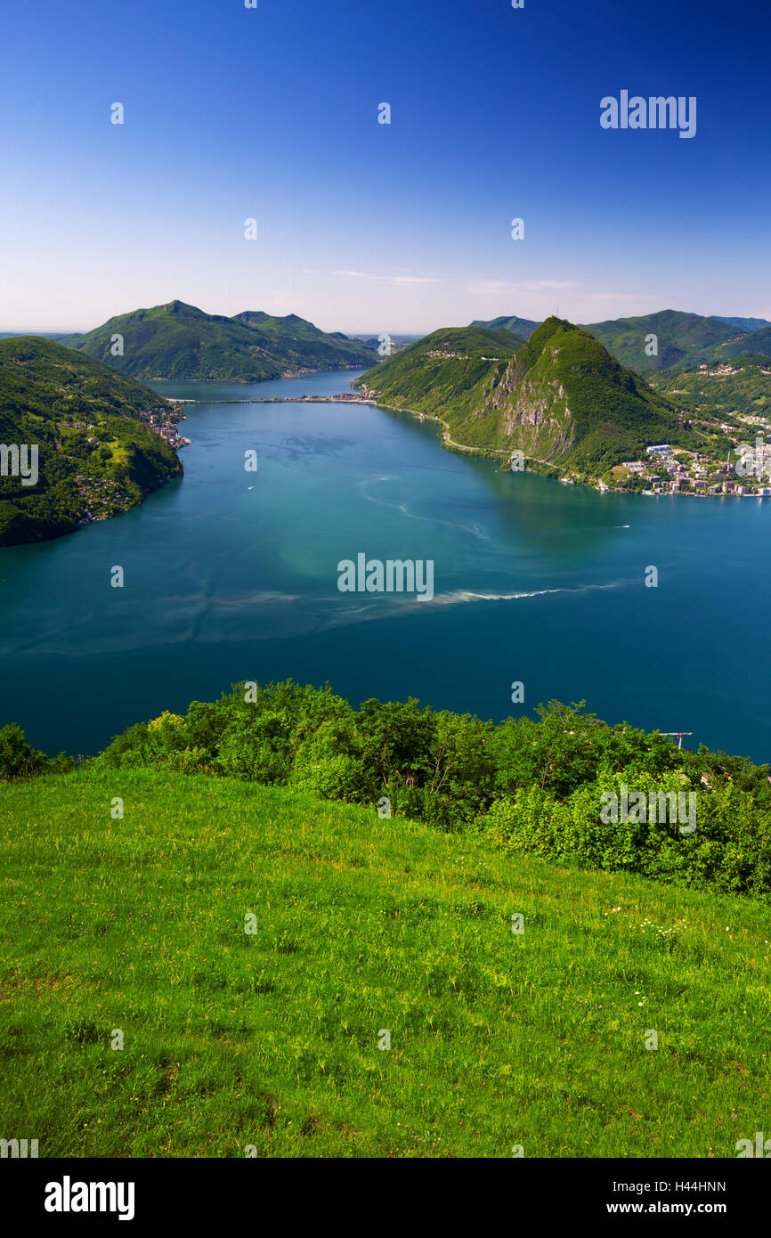 View to Lugano city, Lugano lake and Monte San Salvatore from Monte Bre, Ticino, Switzerland Stock Photo