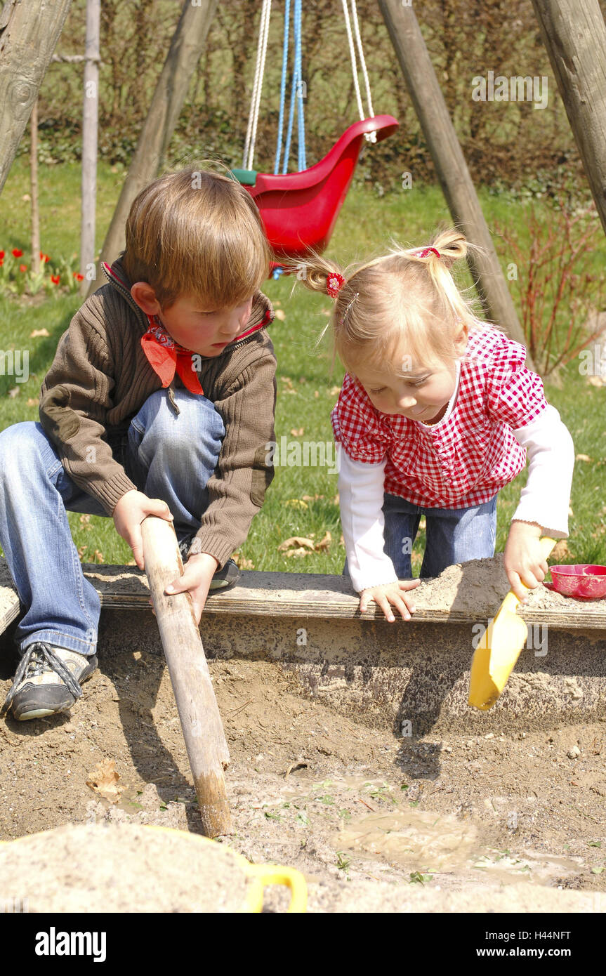 Sandbox, children, girls, boy, play, people, garden, playground, siblings, brother, sister, infants, swing, Sand, - Stock Image