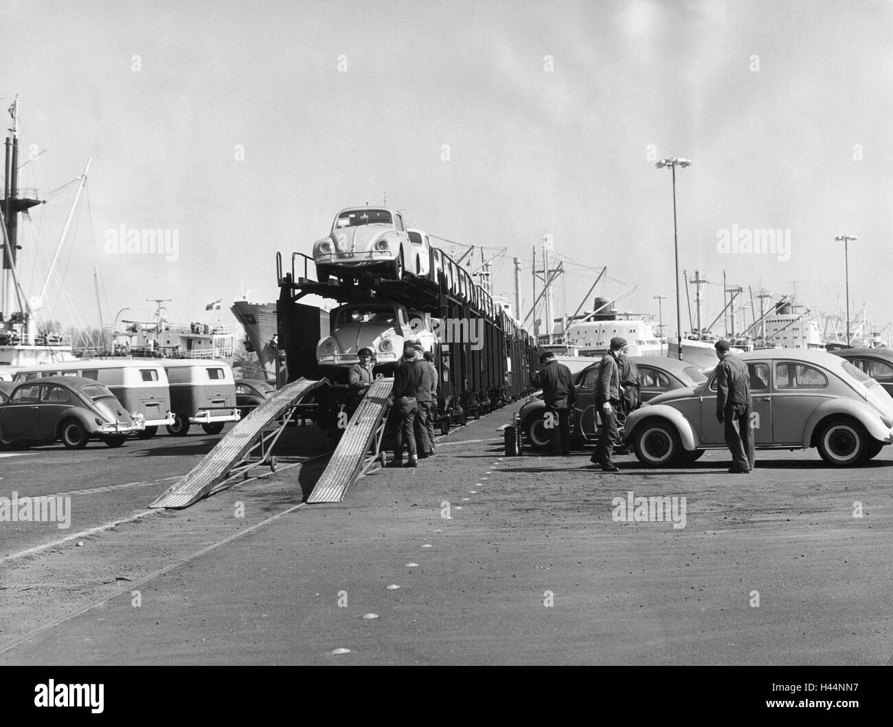 Germany, port, freight cars, workers, VW Beetle, loaded, economy, auto industry, cargo port, road transport, trade, - Stock Image