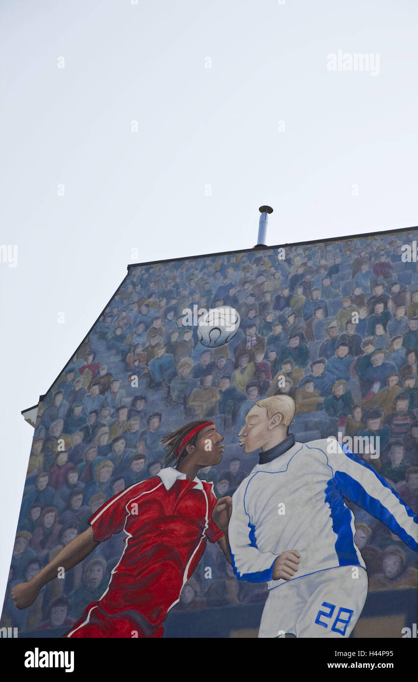 Building, facade, detail, painting, football player, graffiti, outside, architecture, town, residential house, old - Stock Image
