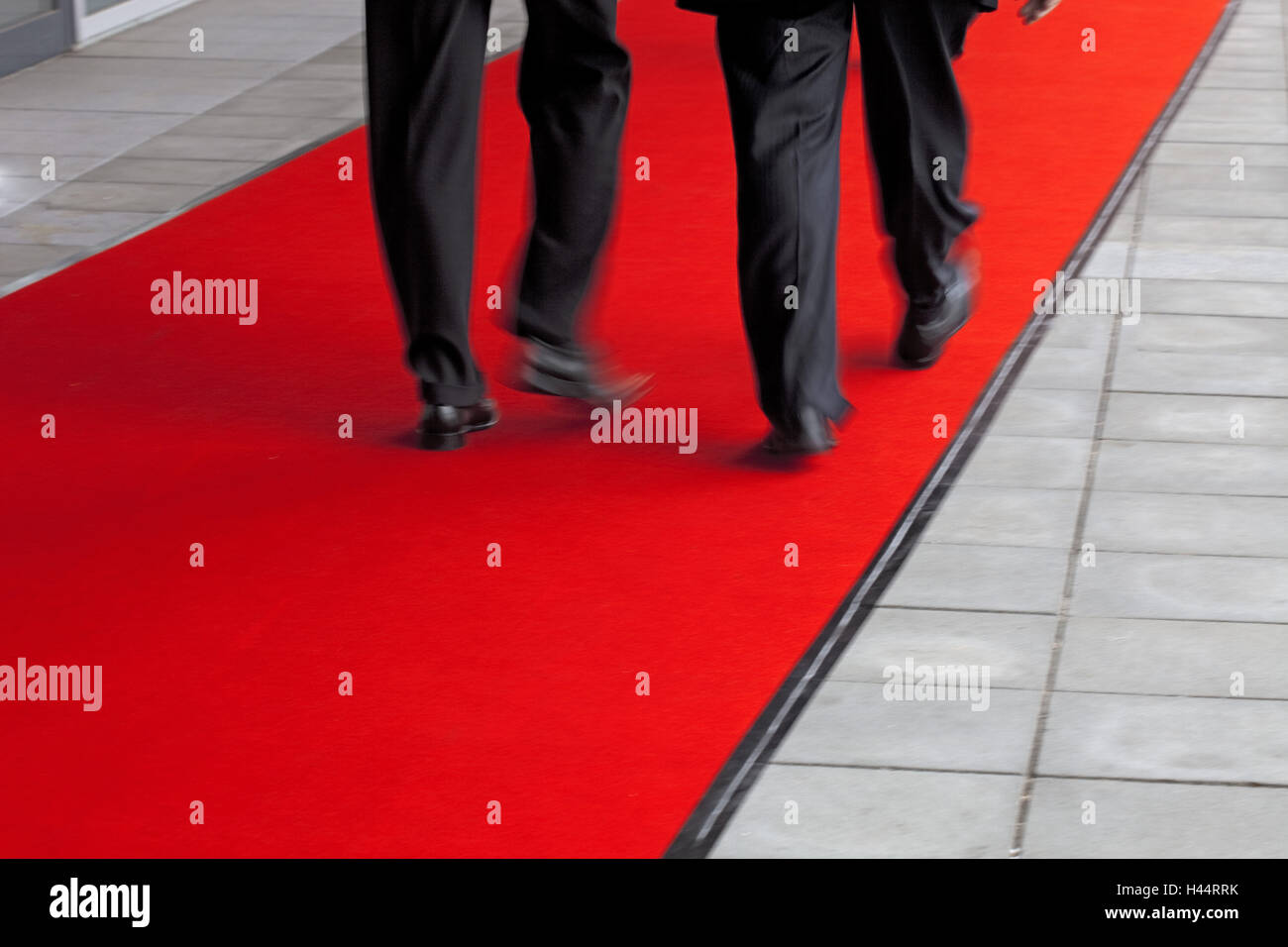 Business people on a red carpet, detail, - Stock Image