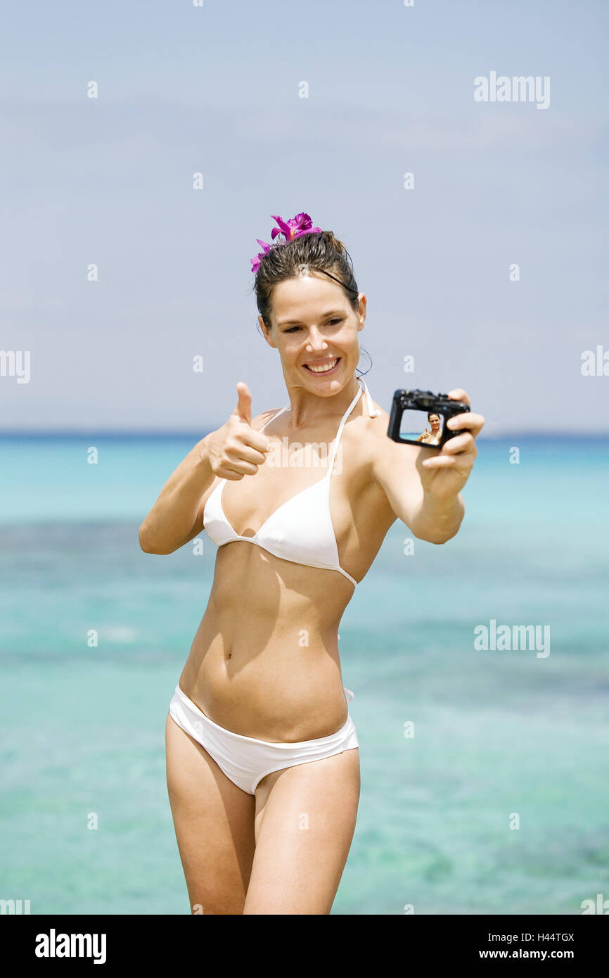 Beach, woman, bikini, digital camera, selfportrait, bather, person, brunette, swimwear, Beauty, solar bath, the - Stock Image