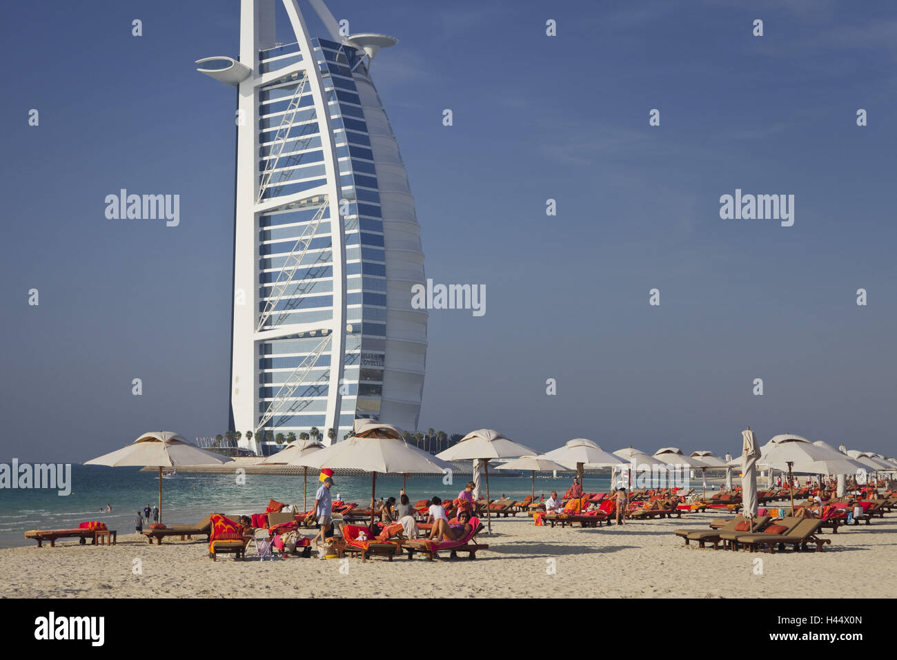 United Arab Emirates, Dubai, Burj Al Arab, Jumeirah Beach, bathers, - Stock Image