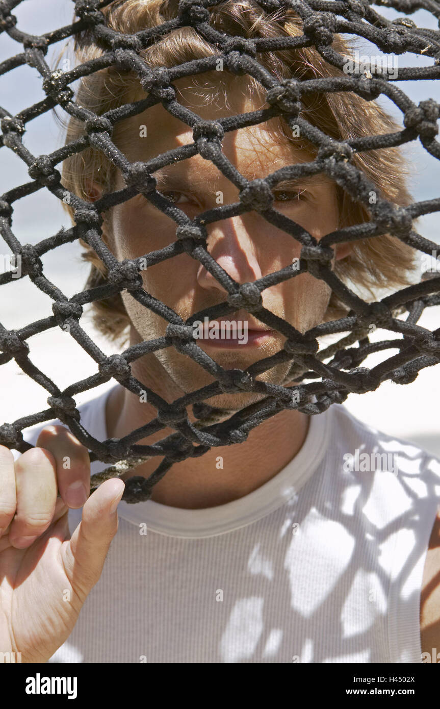 Man, young, network, sees through, portrait,  broached,   20-30 years, 30-40 years, blond, hammock, gaze, network, - Stock Image