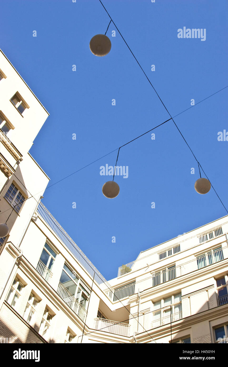 Germany, Berlin, backyard, cable, lamps, from below, - Stock Image