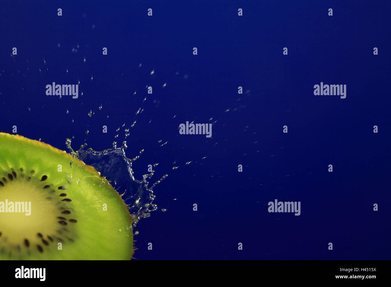Kiwi, halves, drops water, - Stock Image
